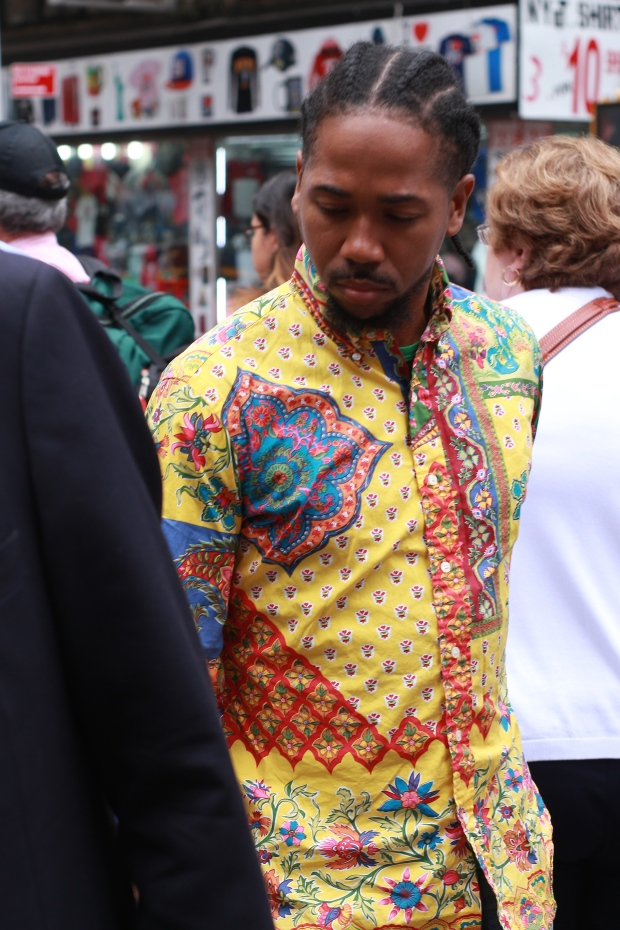 portrait of man in colourful t-shirt in new york