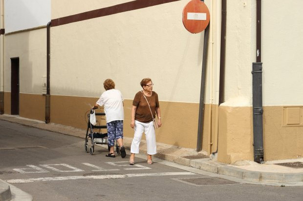 street photography of two women in the street in corella, spain, stop sign
