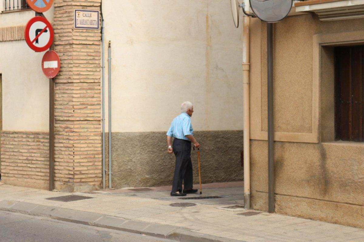 single man walking street photography spain