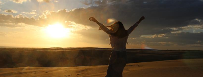 happy sunset silhouette in sand dunes australia