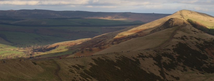 sunlight on peak district mountains