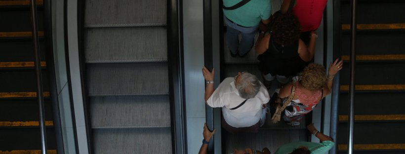 people on one side of escalator